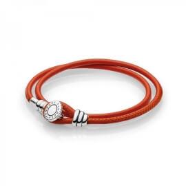 Браслет из кожи оранжевого цвета с деталями из серебра с инкрустацией